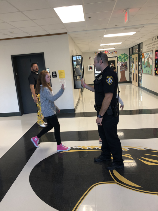 Officer White greeting 6th graders at CVMS