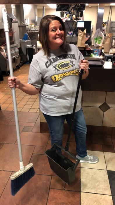 Mrs. Brown helps sweep up!