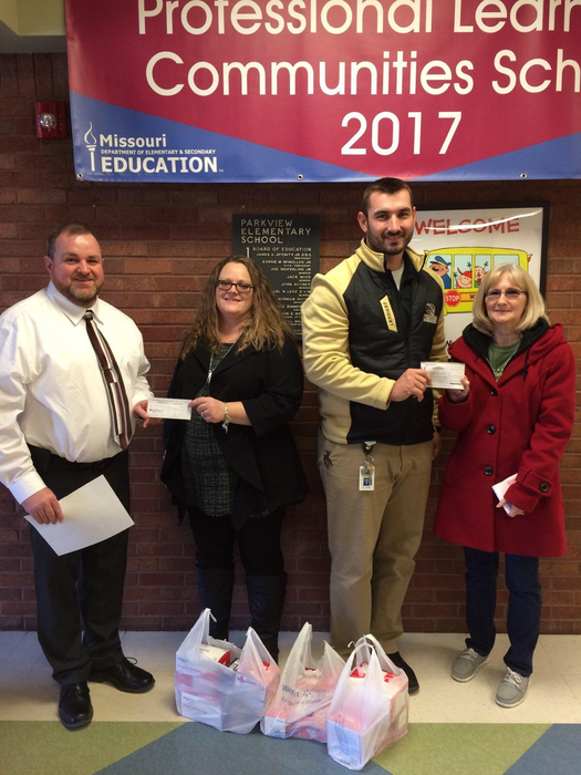 Parkview Elementary Administrators accept donation from the staff of Cameron's Western Missouri Correctional Center and Crossroads Correctional Center.