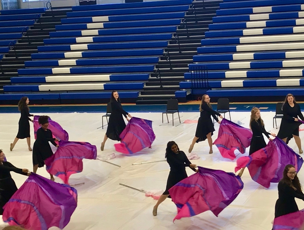 Cameron Winter guard performs at Liberty High School